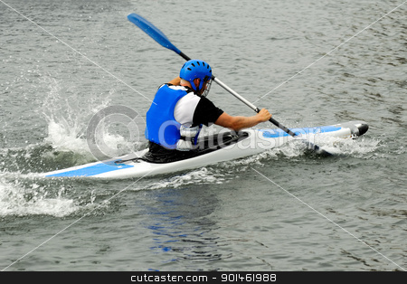 Man racing in kayak stock photo, Man is racing in his kayak. by Lars Christensen