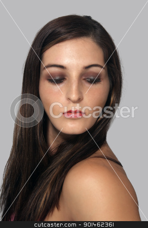 Lovely Young Brunette, Headshot (2) stock photo, A close-up of a lovely young brunette looking down and over her left shoulder. by Carl Stewart