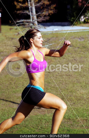 Beautiful Brunette Sprinting Outdoors (1) stock photo, A lovely young athlete sprinting outdoors. by Carl Stewart