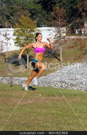 Beautiful Brunette Sprinting Outdoors (2) stock photo, A lovely young athlete sprinting outdoors.  Generous copyspace. by Carl Stewart