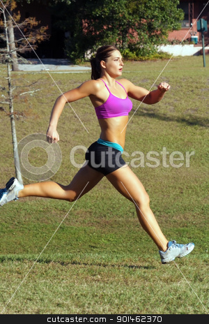 Beautiful Brunette Sprinting Outdoors (3) stock photo, A lovely young athlete sprinting outdoors. by Carl Stewart