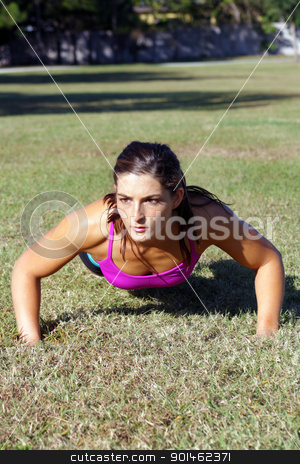 Beautiful Brunette Does Pushups Outdoors (1) stock photo, A lovely young athlete does pushups outdoors.  Generous copyspace. by Carl Stewart