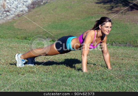 Beautiful Brunette Does Pushups Outdoors (3) stock photo, A lovely young athlete does pushups outdoors.  Generous copyspace. by Carl Stewart