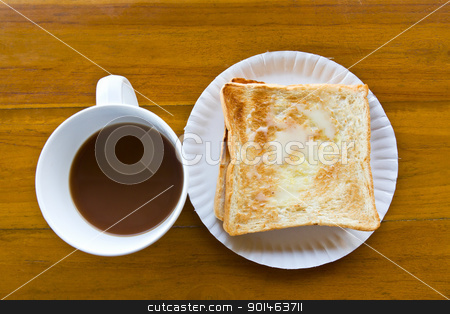 Coffee cup and Pour the milk toast stock photo, Coffee cup and Pour the milk toast on the wooden table by stoonn
