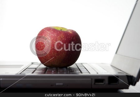 Apple On A Laptop stock photo, Education concept with an apple resting on an open laptop computer, studio on white by Stephen Gibson