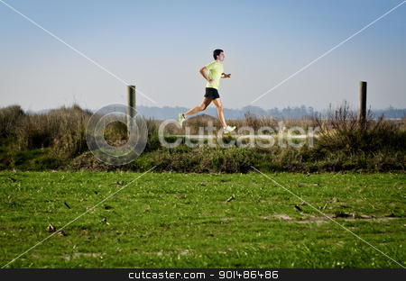 Running stock photo, Male runner at sprinting speed training for marathon outdoors on country landscape. by Homydesign