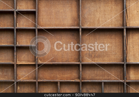 wooden box with bins stock photo, a detail of vintage grunge wood typesetter drawer with dividers by Marek Uliasz