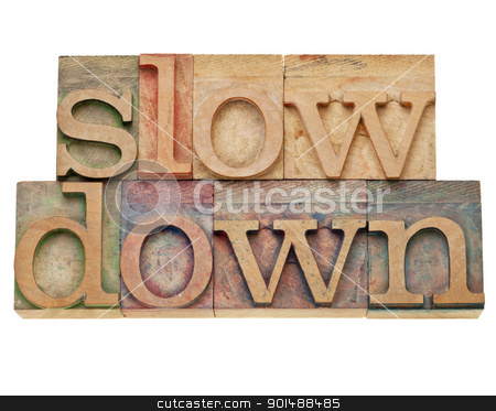 slow down -lifestyle concept stock photo, slow down -lifestyle concept - isolated text in vintage wood letterpress printing blocks, stained by color inks by Marek Uliasz