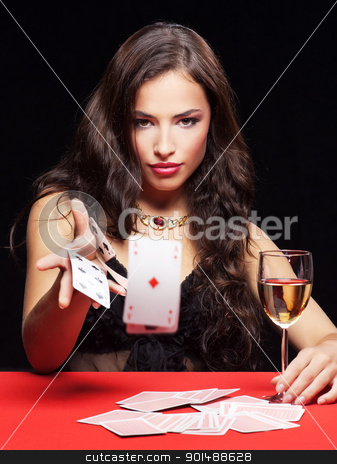 woman gambling on red table stock photo, pretty young woman gambling on red table by iMarin