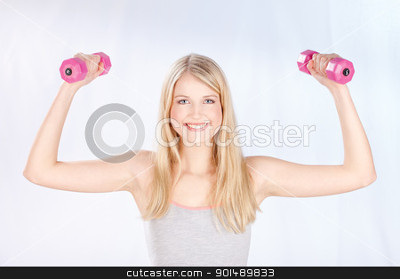 smiled woman doing fitness exercises stock photo, Young smiled woman doing fitness exercises by iMarin