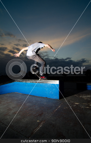 Skateboarder on a grind stock photo, Skateboarder on a grind at the local skatepark. by Homydesign