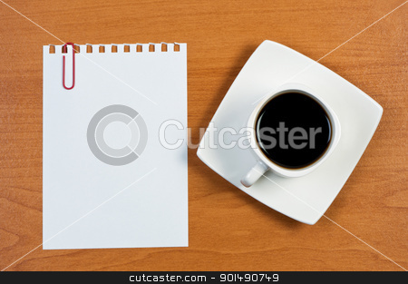 Torn sheet of paper clips and coffee on table. stock photo, Torn sheet of paper clips and coffee on table. by Borys Shevchuk