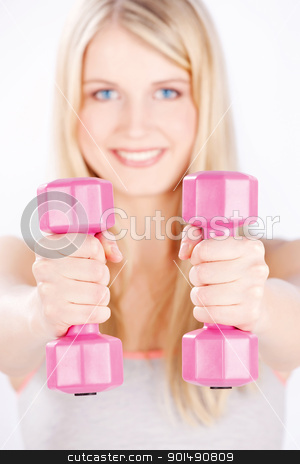 two weights in woman's hands stock photo, Young woman with two weights doing fitness exercises, focus on weights by iMarin