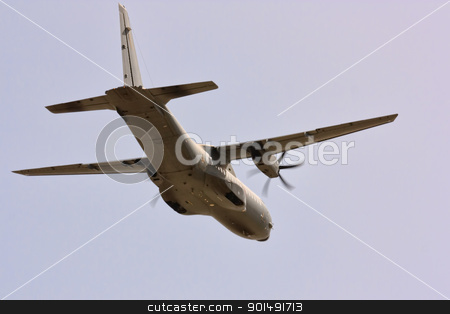 Cargo Plane stock photo, Propeller cargo plane flying against clear blue sky by Paulo M.F. Pires