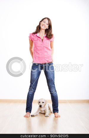 Girl and her best friend stock photo, Beautiful young woman  with a cute puppy under her legs by ikostudio