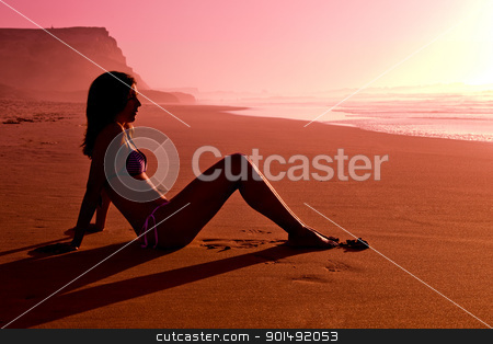 Girl on beach  stock photo, A beautiful woman sit on sand  by ikostudio