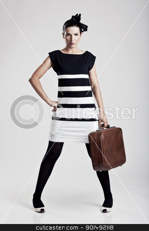 Fashion woman posing stock photo, Portrait of a beautiful fashion woman posing and holding a old suitcase by ikostudio