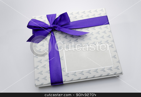 Printed over a purple ribbon gift box stock photo, Printed over a purple ribbon gift box by Turhan Yalçın