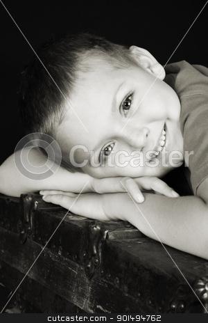 Beautiful boy stock photo, Beautiful blond boy lying on an antique trunk by Vanessa Van Rensburg