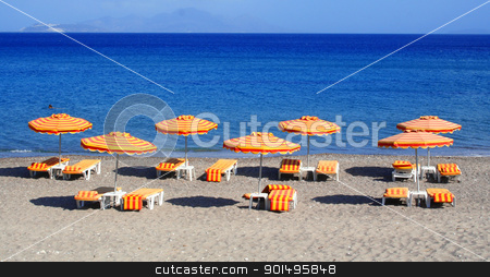 Greece. Kos island. Kefalos beach.  stock photo, Greece. Kos island. Kefalos beach. Orange chairs and umbrellas on the beach  by Morozova Oxana