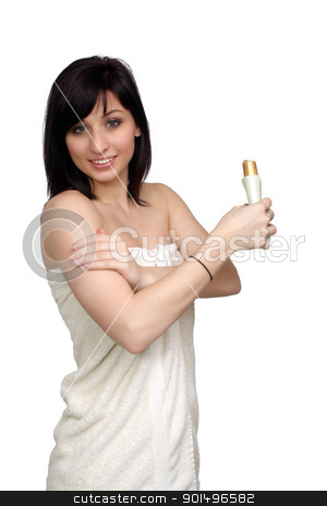 Beautiful Young Woman Wearing a Bath Towel (4) stock photo, A studio close-up of a lovely young woman wrapped in a white bath towel, rubbing lotion on her arm, isolated on a white background. by Carl Stewart