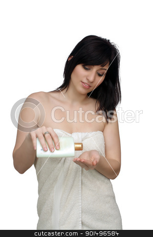 Beautiful Young Woman Wearing a Bath Towel (6) stock photo, A studio close-up of a lovely young woman wrapped in a white bath towel, pouring lotion into her hand.  Isolated on a white background. by Carl Stewart