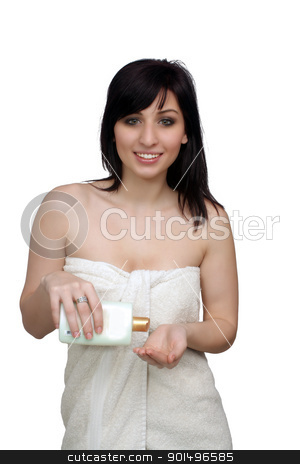 Beautiful Young Woman Wearing a Bath Towel (7) stock photo, A studio close-up of a lovely young woman wrapped in a white bath towel, pouring lotion into her hand.  Isolated on a white background. by Carl Stewart
