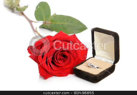 Engagement Ring Box stock photo, A diamond engagement ring in a jewellery box, shot next to a red rose, isolated against a white background. by Richard Nelson