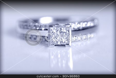Engagement Ring stock photo, Closeup shot of a diamond engagement ring shot on a grey background. by Richard Nelson
