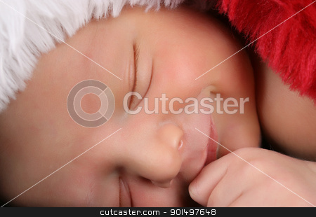 Newborn christmas baby stock photo, Newborn baby boy wearing a christmas hat by Vanessa Van Rensburg