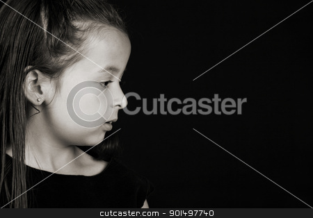 Serious girl stock photo, Serious little brunette girl against a black background by Vanessa Van Rensburg