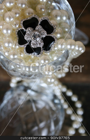Flower Diamond stock photo, Black flower diamond ring amongst pearls in crystal glass by Vanessa Van Rensburg
