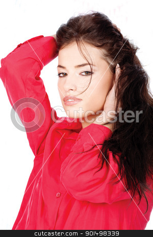 Woman in a red shirt with hands in her black hair stock photo, portrait of a young woman in a red shirt with hands in her black hair by iMarin