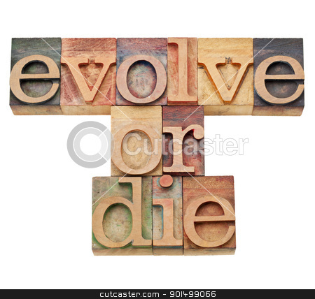 evolve or die -  evolution  concept  stock photo, evolve or die -  evolution or adaptation concept -  isolated text in vintage wood letterpress type, stained by color inks by Marek Uliasz
