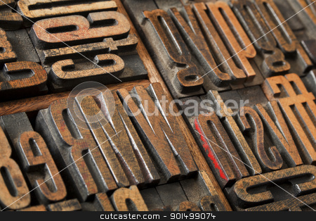 antique letterpress type abstract stock photo, antique wood letterpress printing blocks  (condensed gothic font) in old box typesetter box, abstract with selective focus by Marek Uliasz