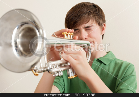 Teen playing silver trumpet stock photo, Photo of a young teen playing his silver trumpet. by © Ron Sumners