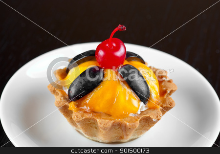 cupcake stock photo, fresh baked cupcake closeup on a wooden table by olinchuk