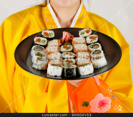 sushi stock photo, woman at bright cloth holding plate with fresh sushi set on it by olinchuk