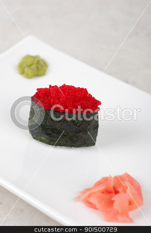 Red tobiko sushi stock photo, Red tobiko with flying fish roe sushi closeup by olinchuk