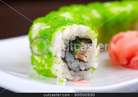 sushi rolls stock photo, Sushi rolls made of salmon, avocado, flying fish roe - tobiko caviar and philadelphia cheese by olinchuk