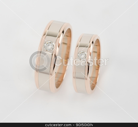 two gold rings stock photo, Celebratory accessories - two gold rings for wedding day by olinchuk