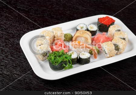 sushi set stock photo, japanese sushi set and sushi with green seaweed closeup in the foreground by olinchuk