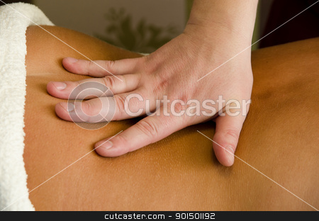 massage stock photo, closeup of young woman getting a back massage by olinchuk