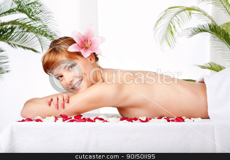 spa treatment in salon stock photo, Pretty woman with flower in her hair, waiting for spa, massage treatment by iMarin