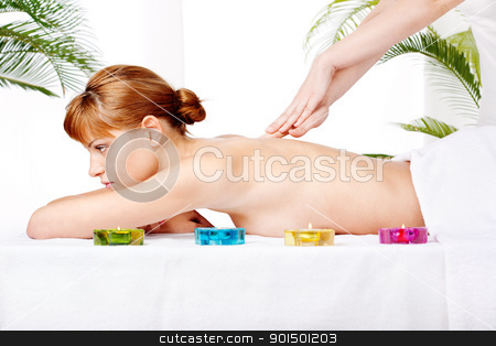 back massage treatment stock photo, Pretty woman getting a back massage treatment in salon by iMarin