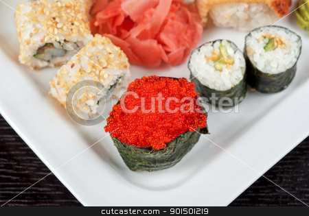 sushi set stock photo, japanese sushi set with red tobiko sushi in the foreground by olinchuk