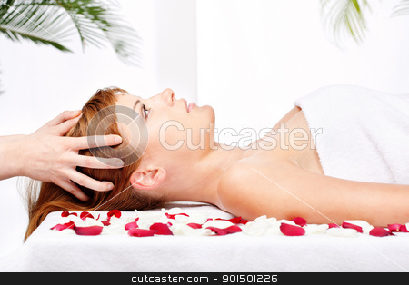 woman on head massage treatment in salon stock photo, Pretty woman on head massage treatment in salon by iMarin