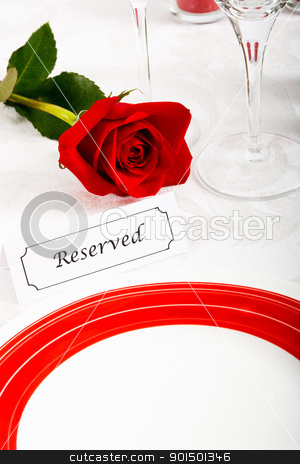 Reserved Restaurant Table stock photo, A romantic red and white place setting shows a reserved table at an elegant restaurant ready to celebrate an anniversary or Valentines Day. by Karen Sarraga