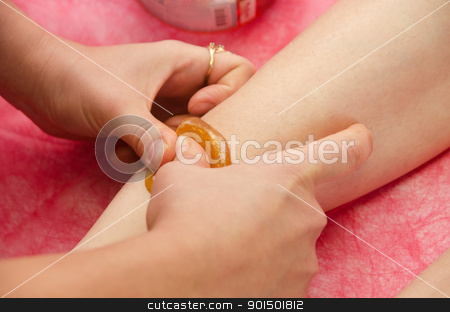 sugaring epilation stock photo, Sugaring: epilation with liquate sugar at legs. It is less painful hair removal with wax replacement by olinchuk