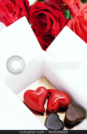 red roses and hearts for Valentine's Day stock photo, red roses  and hearts (stone heart and chocolate hearts ) for Valentine's Day. Love and harmony concept by klenova